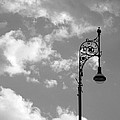 Lampost And Clouds In Wroclaw Poland by Greg Matchick
