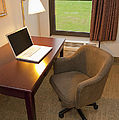 Laptop On A Hotel Room Desk by Thom Gourley/Flatbread Images, LLC