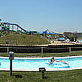 Lazy River Panorama At A Water Park by Thomas Woolworth