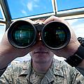 Lieutenant Uses Binoculars To Scan by Stocktrek Images