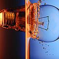 Light Bulb Shot Into Water by Setsiri Silapasuwanchai