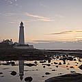 Lighthouse At Low Tide by David Pringle