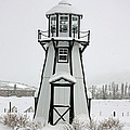 Lighthouse In The Snow by Greg Plamp