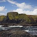 Lighthouse On Coastal Cliff by Craig Tuttle