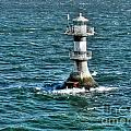 Lighthouse On The Blue Sea by Mats Silvan
