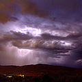 Lightning Strikes During A Thunderstorm by David R Frazier and Photo Researchers