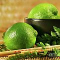 Limes with chopsticks by Sandra Cunningham