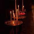 Lit Candles In A Church by Louise Heusinkveld