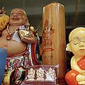 Little Buddhas In Silom In Bangkok In Thailand by Shaun Higson