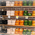 Little Cheeses On A Shelf In Amsterdam by Trude Janssen