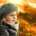 Little Girl In Autumn Leaves Scenery At Sunset by Waldek Dabrowski
