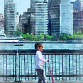 Little Girl On Scooter By Manhattan Skyline by Susan Savad