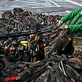 Logistics Specialist Wraps Cargo Nets by Stocktrek Images