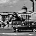London Cab In Trafalgar Square by Aldo Cervato