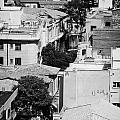 looking down over rooftops to ledra street crossing and  restricted area of the UN buffer zone  by Joe Fox