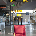 Luggage Sitting Alone In An Airport Terminal by Jaak Nilson