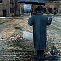 Man In Vintage Clothing With Umbrella On Rainy Brick Street by Jill Battaglia