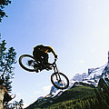 Man Jumping On His Mountain Bike by Mark Cosslett