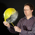 Man Popping A Balloon by Ted Kinsman