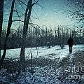 Man Walking In Snow At Winter Twilight by Sandra Cunningham