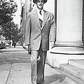 Man Walking On Sidewalk, (b&w) by George Marks
