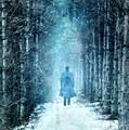 Man Walking Through Snowy Woods by Jill Battaglia