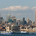 Manhattan Skyline And Ferry Traffic by Clarence Holmes