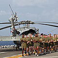 Marines And Sailors Run Aboard Uss by Stocktrek Images