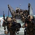 Marines Disembark A Landing Craft by Stocktrek Images