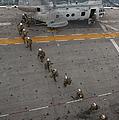 Marines Embark A Ch-46e Sea Stallion by Stocktrek Images
