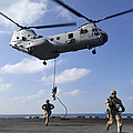 Marines Fast Rope From A Ch-46e Sea by Stocktrek Images