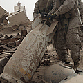 Marines Lift Up A Bomb To Determine If by Stocktrek Images