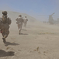 Marines Move Through A Dust Cloud by Stocktrek Images