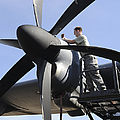 Mechanic Finishes Moving An Engine by Stocktrek Images