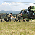 Medical Personnel Carry A Wounded by Stocktrek Images