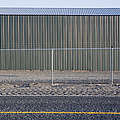 Metal Storage Shed Behind Fence by Paul Edmondson