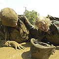 Midshipmen Maneuver Through A Mud Pit by Stocktrek Images