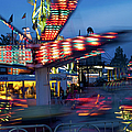 Midway Blur by Paulette B Wright