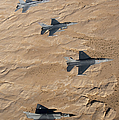 Military Fighter Jets Fly In Formation by Stocktrek Images