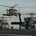 Military Helicopters Land On The Flight by Stocktrek Images