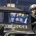 Military Policeman Stands Next by Michael Wood
