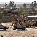 Military Vehicles Parked Outside Loy by Stocktrek Images