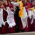 Monks Wait For The Dalai Lama by Don Schwartz