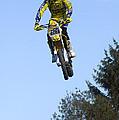 Motocross Rider Jumping High by Matthias Hauser
