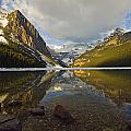 Mountains Reflected In Lake Louise by Mike Grandmailson