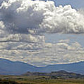 Mt Shasta On A Showery Spring Day by Mick Anderson
