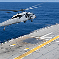 N Mh-60s Sea Hawk Helicopter Lifts by Stocktrek Images