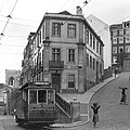 Narrow Streets And Streetcar In Lisbon by W Robert Moore