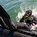 Navy Diver Dives Into San Diego Bay by Stocktrek Images