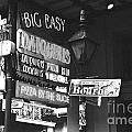 Neon Sign On Bourbon Street Corner French Quarter New Orleans Black And White Film Grain Digital Art by Shawn O'Brien
